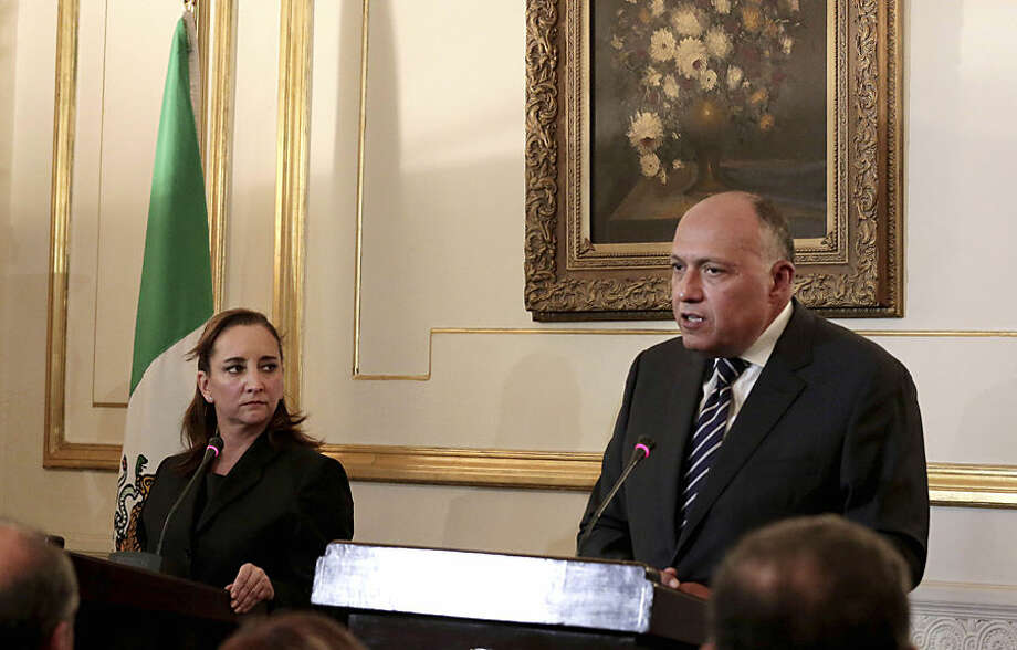 Mexico's Secretary of Foreign Affairs Claudia Ruiz Massieu, left, listens to Egyptian Foreign Minister Sameh Shoukry speak during a joint press conference in Cairo, Egypt, Wednesday, Sept. 16, 2015. Massieu arrived in Egypt early Wednesday morning seeking answers in the wake of the deaths of eight Mexican tourists after Egyptian security forces mistakenly attacked a desert safari. (AP Photo/Nariman El-Mofty)