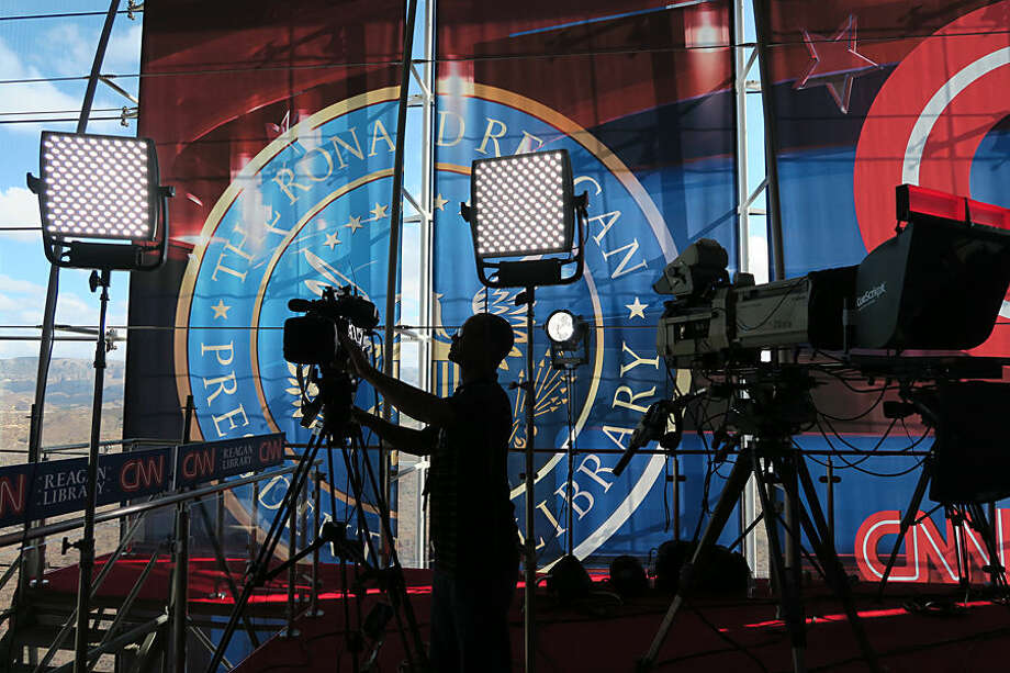 A technician adjusts a television camera before the start of the CNN Republican presidential debates at the Ronald Reagan Presidential Library and Museum Wednesday, Sept. 16, 2015 in Simi Valley, Calif. (AP Photo/Tom Stathis)