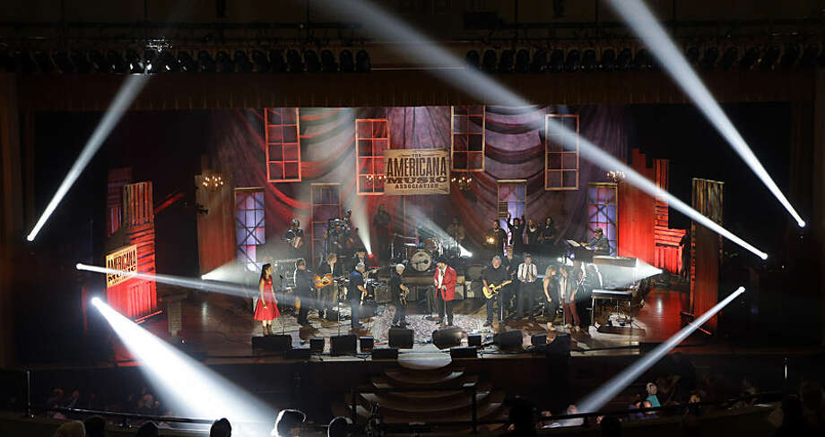 Performers including Los Lobos, The Mavericks, The McCrary Sisters, Buddy Miller and Rhiannon Giddens share the stage for the final song at the Americana Music Honors and Awards show Wednesday, Sept. 16, 2015, in Nashville, Tenn. (AP Photo/Mark Zaleski)