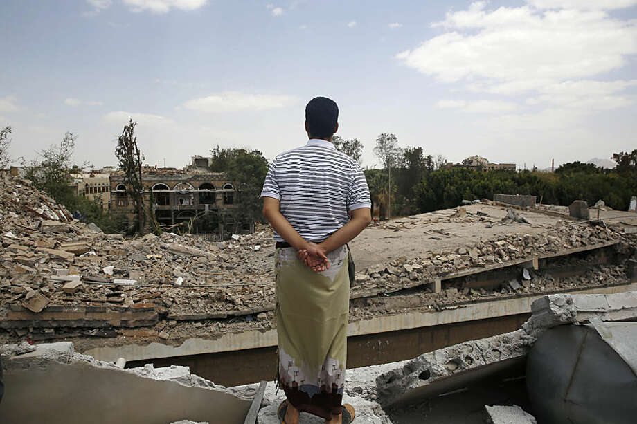 A man looks at the Houthi-controlled headquarters of the Yemeni army destroyed by Saudi-led airstrikes in Sanaa, Yemen, Wednesday, Sept. 16, 2015. The Shiite rebels known as the Houthis still control Sanaa, and are resisting a push by pro-government forces along several front lines around the country. (AP Photo/Hani Mohammed)