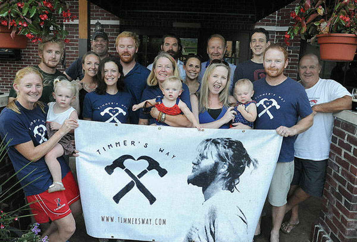 Kristin Woods and family members with their banner at O'Neill's promoting the Timmer's Way Music Festival fundraiser for MS research. Photo/Matthew Vinci
