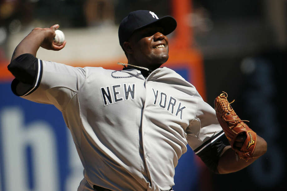 New York Yankees starting pitcher Michael Pineda throws to the New York Mets during the first inning of a baseball game, Saturday, Sept. 19, 2015, in New York. (AP Photo/Julio Cortez)