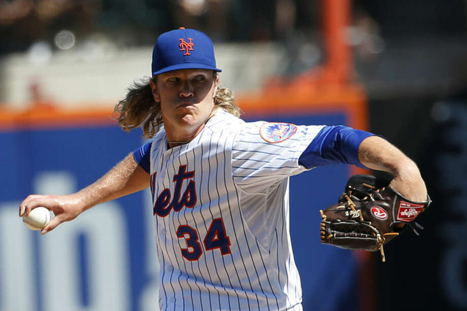 New York Mets starting pitcher Noah Syndergaard throws to the New York Yankees during the first inning of a baseball game, Saturday, Sept. 19, 2015, in New York. (AP Photo/Julio Cortez)