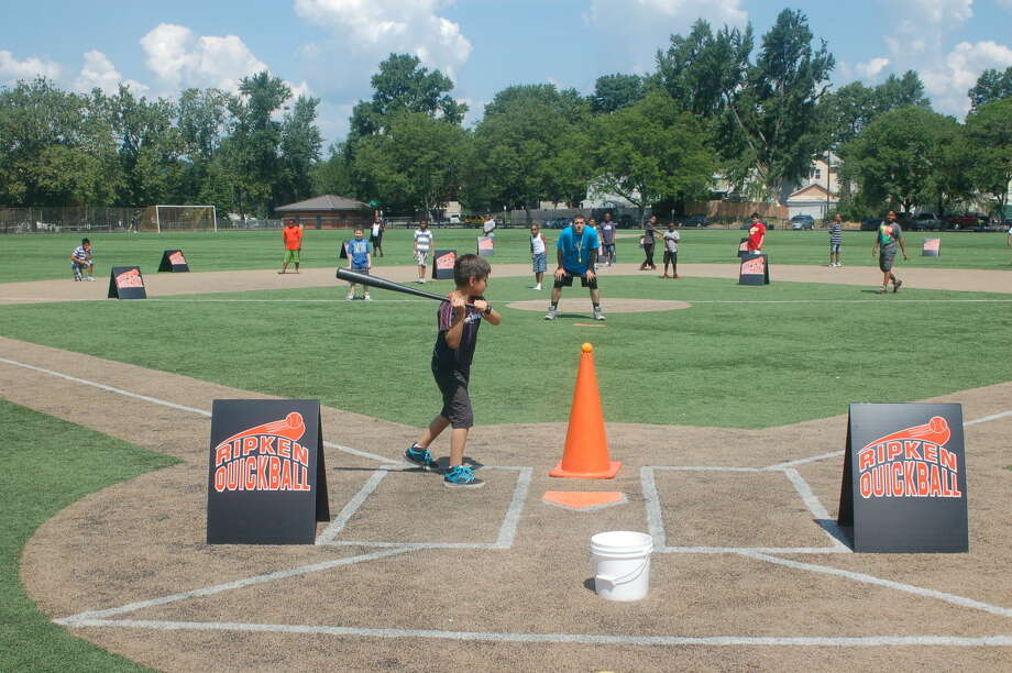 Boys & Girls Club member takes his turn at bat in Monday's Quickball tournament, hosted by the Boys & Girls Club of Stamford and the Cal Ripken, Sr. Foundation.