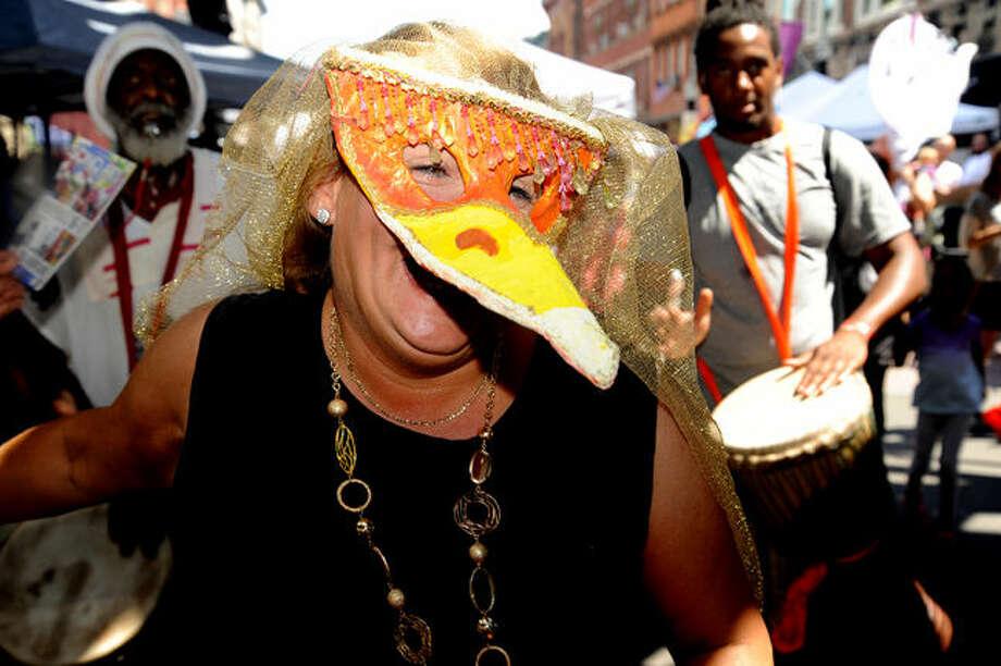 The SONO Arts puppet parade Sunday on Washington Street. Hour photo/Matthew Vinci