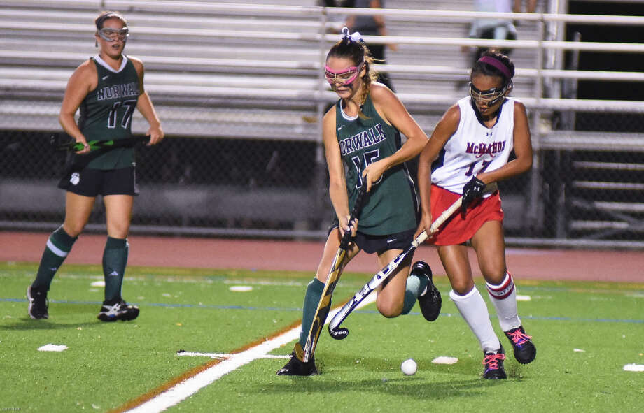 Hour photo/John Nash - Action and reaction from Norwalk vs. Brien McMahon field hockey on Wednesday, Sept. 16, 2015