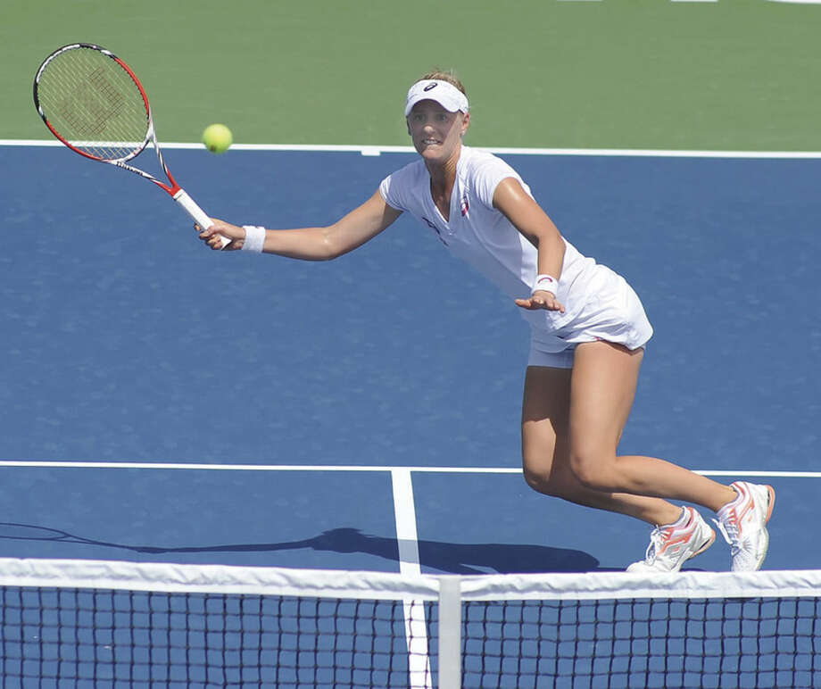 Hour photo/John NashAlison Riske of Pittsburgh, Pa., won her opening match in Sunday's first round of the 2014 Connecticut Open at Yale Univesity in New Haven. After all the matches were played out on Sunday, Riske was the last American standing in the tournament.