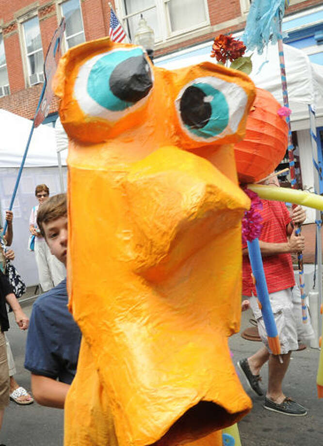 Larger than life puppets march in the SONO Arts puppet parade Sunday on Washington Street. Hour photo/Matthew Vinci
