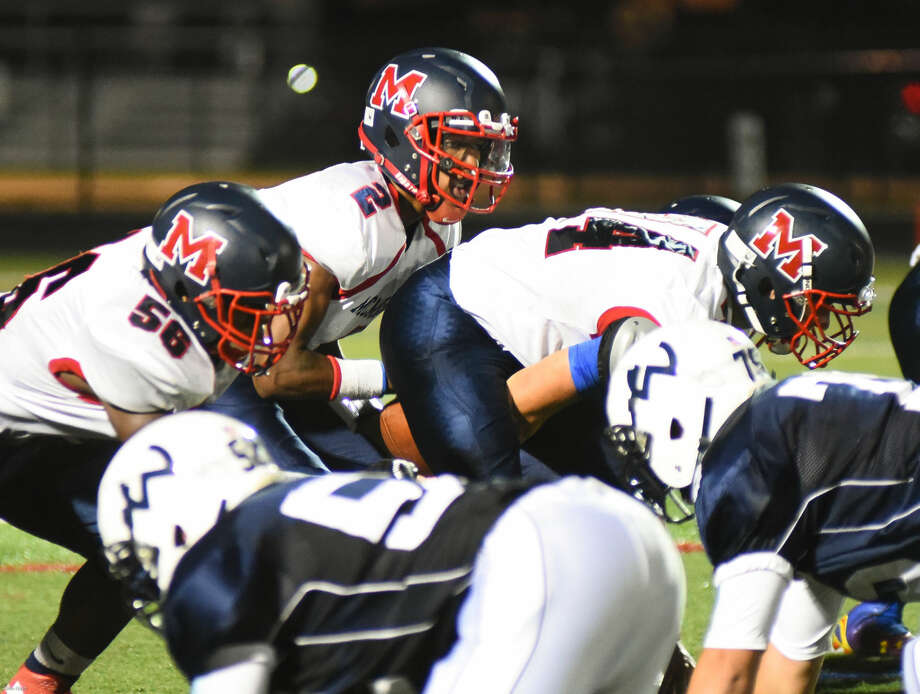 Hour photo/John Nash - Action and reaction from Brien McMahon's 28-3 win over Wilton on Friday night, Sept. 18, 2015, at Fujitani Field in Wilton.