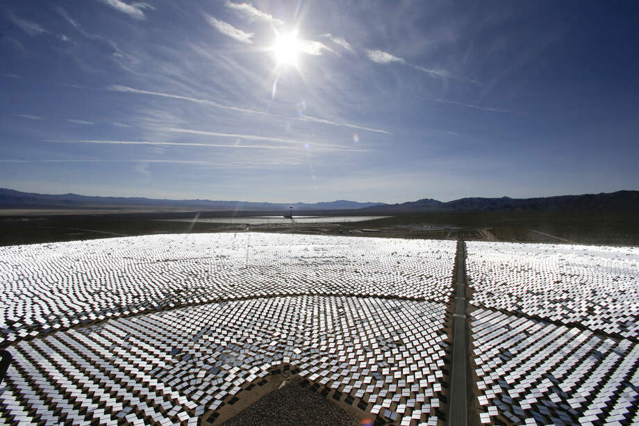 FILE - This Feb. 11, 2014 file photo shows some of the 300,000 computer-controlled mirrors, at the Ivanpah Solar ElectirIc Generating System in Primm, Nev. New estimates for the Ivanpah solar plant, an innovative year-old $2.2 billion solar project with Google as a major investor, say thousands of birds are dying yearly, roasted by the concentrated sun rays from the more than 300,000 mirrors. (AP Photo/Chris Carlson, File)