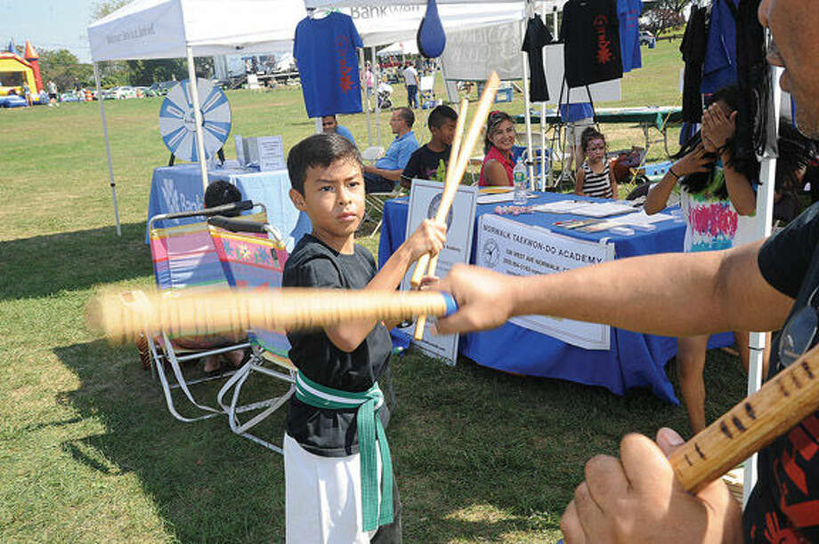Jake Tejada 9, shows off his skills in Kali and Taekwon-Do at the Taekwon-Do Academy tent. One of the many attractions at the Live Green Connecticut event Saturday. Hour photo/Matthew Vinci