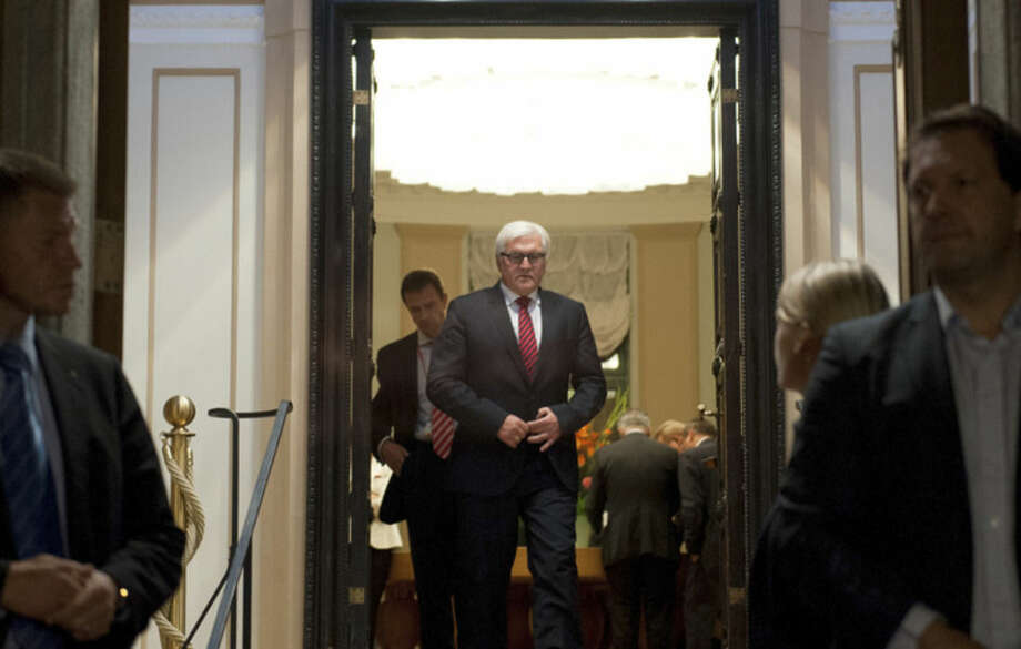 Foreign Minister of Germany Frank-Walter Steinmeier steps out to brief the media after a meeting with his counterparts from Ukraine, Russia, and France at the Guesthouse of Foreign Ministry Villa Borsig in Berlin, Monday, Aug. 18, 2014. The talks aimed at finding a political solution to the conflict in Ukraine ended without any substantial result. (AP Photo/Steffi Loos)