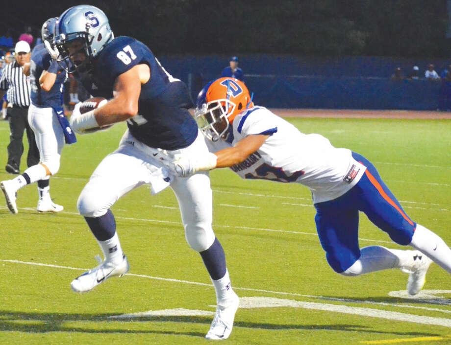 Staples' Ryan Fitton runs out of would be Danbury tackler on his way to the end zone on Friday. (Pete Paguaga/Hour photo)