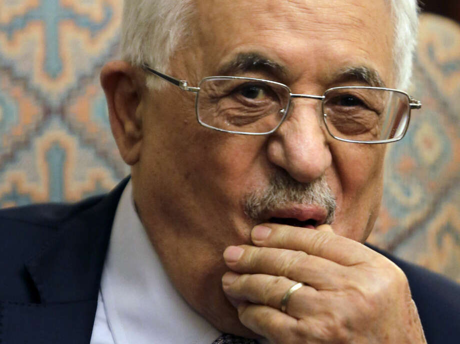 FILE - In this Wednesday, July 16, 2014, file photo, Palestinian President Mahmoud Abbas listens to Arab League Secretary General Nabil Elaraby during their meeting at his residence in Cairo. With a deadline just hours away, Egyptian mediators shuttled between Israeli and Palestinian negotiators, Monday, Aug. 18, 2014, in hopes of salvaging a long-term cease-fire arrangement that would allow reconstruction of the Gaza Strip following a monthlong war that killed more than 2,000 people. In an apparent attempt to pressure Hamas, Egypt said it would co-host an international fundraising conference for Gaza, but only if a deal is reached. Israel, meanwhile, said in recent months it had arrested nearly 100 Hamas operatives in the West Bank in an alleged plot to topple Abbas. (AP Photo/Amr Nabil, File)