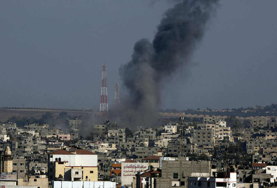 Smoke rises after an Israeli strike hit Gaza City in the northern Gaza Strip, Tuesday, Aug. 19, 2014. The Israeli military said it carried out a series of airstrikes Tuesday across the Gaza Strip in response to renewed rocket fire, a burst of violence that broke a temporary cease-fire and endangered negotiations in Egypt over ending the month long war between Israel and Hamas. The fighting occurred some eight hours before a temporary truce was set to expire. (AP Photo/Adel Hana))