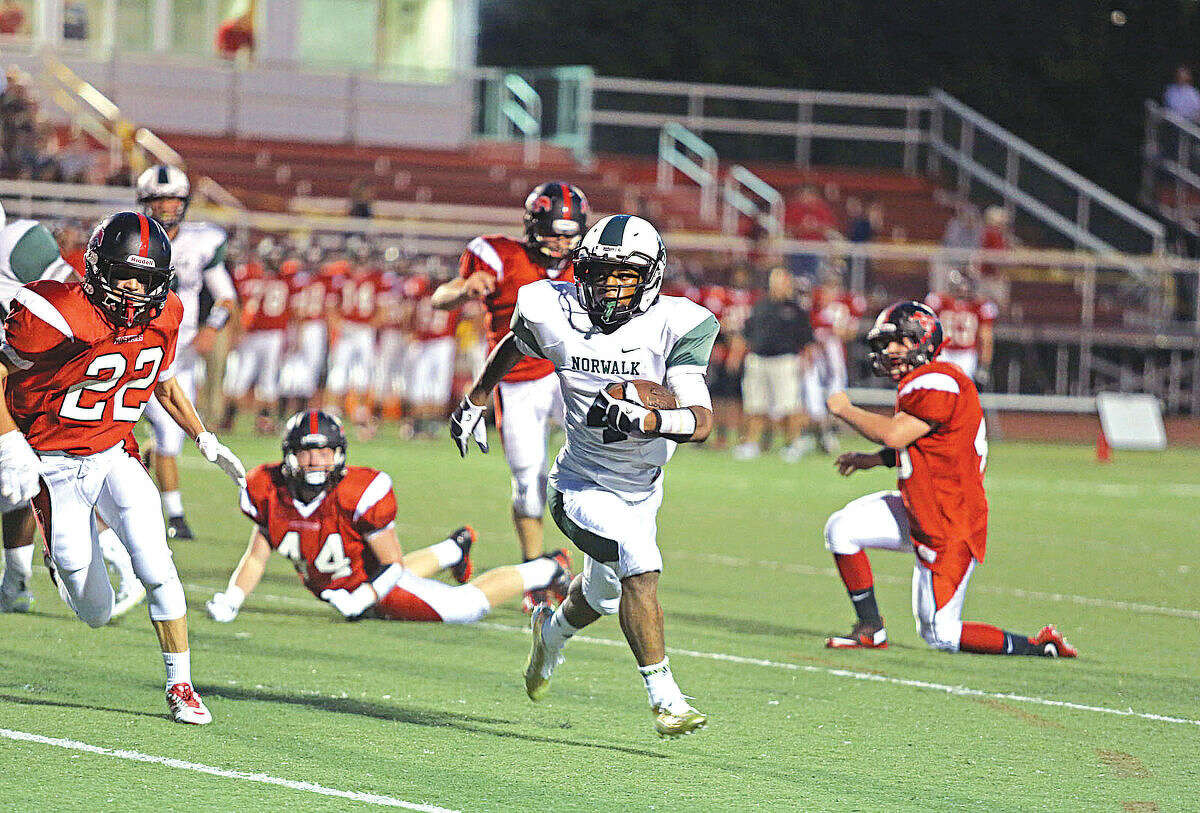 Norwalk High School's #4, Deandre Russell, makes a play during an away game against Fairfield Warde Friday evening. Hour Photo / Danielle Calloway