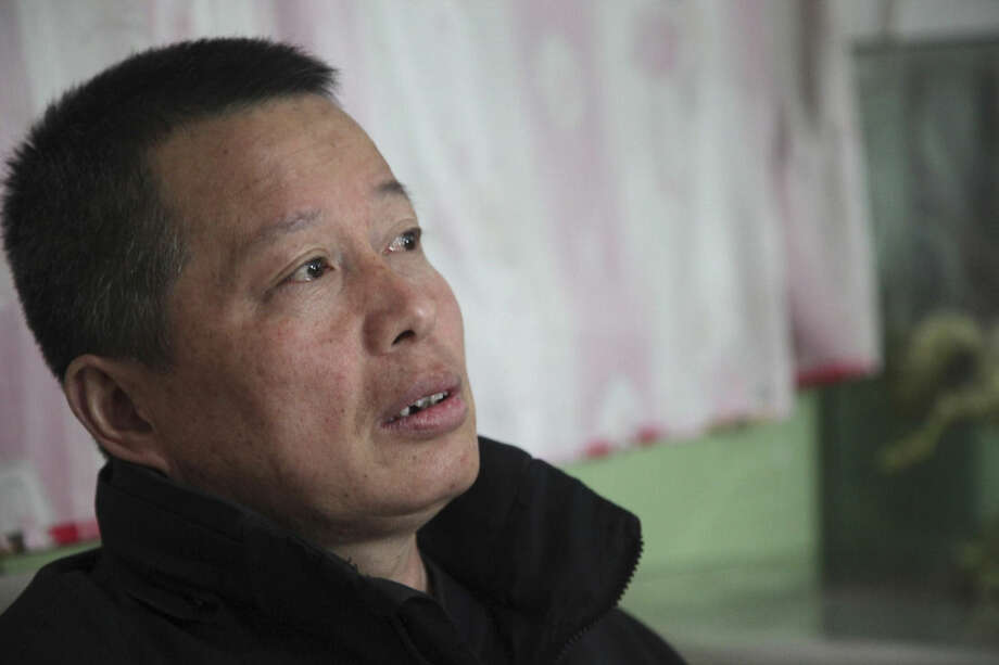 In this Sunday, March 15, 2015 photo, Gao Zhisheng talks to journalists in a cave home in northwestern China's Shaanxi province. Leading Chinese rights lawyer Gao said in his first interview in five years that he was tortured with an electric baton to the face and spent three years in solitary confinement during his latest period of detention since 2010. (AP Photo/Isolda Morillo)