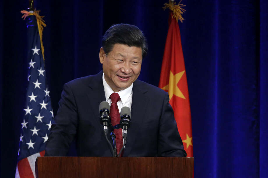 Chinese President Xi Jinping smiles as he speaks Tuesday, Sept. 22, 2015, at a banquet in Seattle. Leaders from Michigan to Beijing attended meetings Tuesday with Xi in the U.S. and signed an agreement to work together to advance renewable energy and clean technologies to combat climate change. (AP Photo/Ted S. Warren)