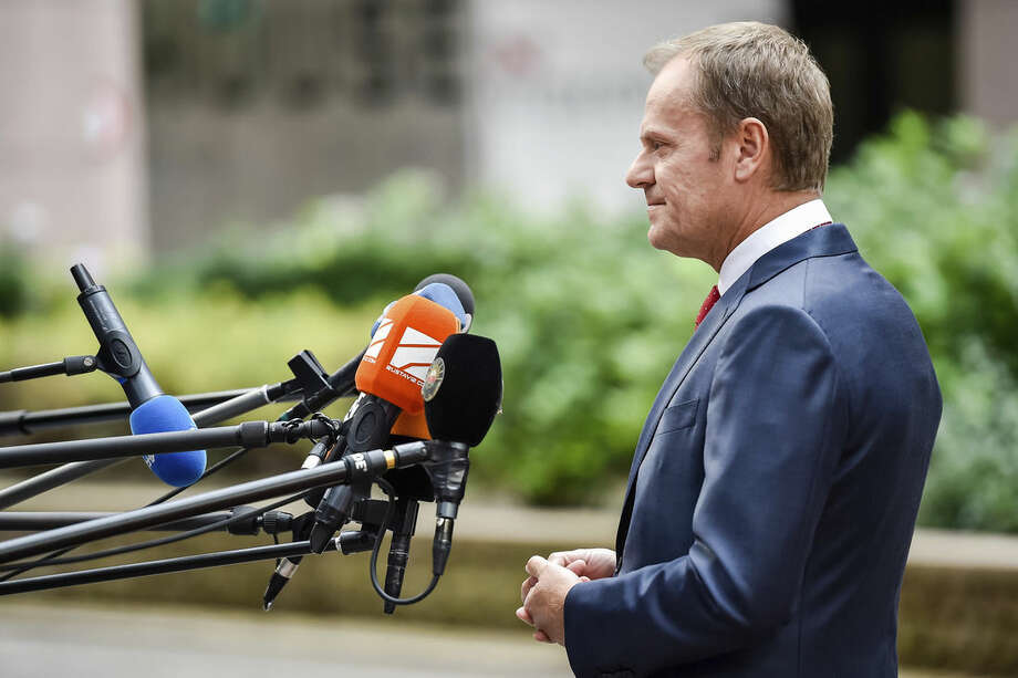 European Council President Donald Tusk addresses the media as he arrives for an emergency EU heads of state summit on migration at the EU Council building in Brussels, Wednesday, Sept. 23, 2015. The European Union hopes to provide more funds for refugees and agree short and long term measures to confront the migration crisis. (AP Photo/Martin Meissner)