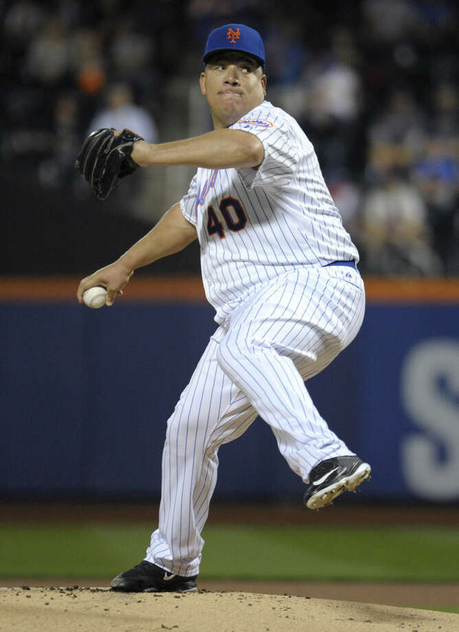 New York Mets pitcher Bartolo Colon delivers the ball to the Atlanta Braves during the first inning of a baseball game Wednesday, Sept. 23, 2015, in New York. (AP Photo/Bill Kostroun)