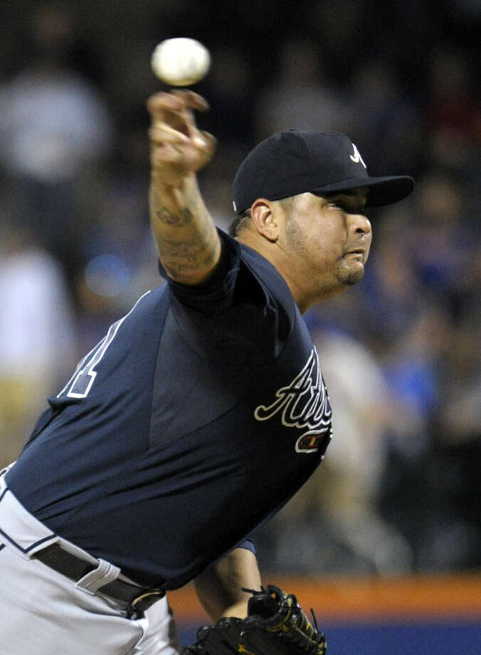 Atlanta Braves pitcher Williams Perez delivers the ball to the New York Mets during the first inning of a baseball game Wednesday, Sept. 23, 2015, in New York. (AP Photo/Bill Kostroun)