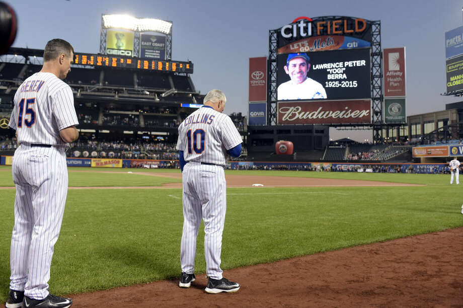 New York Mets bench coach Bob Geren and manager Terry Collins observe a moment of silence for the passing of Hall of Fame catcher Yogi Berra, before the Mets' baseball game against the Atlanta Braves on Wednesday, Sept. 23, 2015, in New York. (AP Photo/Bill Kostroun)