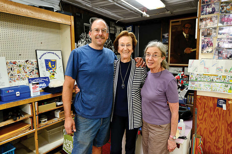Hour photo / Erik Trautmann Longtime Max' art supply employees Jay Cimbak, 29 years, and Nina Royce, 45 years, with the store's owner Shirley Mellor, center. Max's art supply is going out of business after 56 years at their Post Rd East location in downtown Westport.