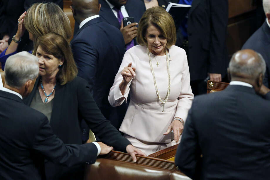 House Minority Leader Nancy Pelosi of Calif. talks with members on the floor of the House on Capitol Hill in Washington, Thursday, Sept. 24, 2015, while waiting for Pope Francis to address a joint meeting of Congress . The Pope will make history as the first pontiff to speak to Congress. (AP Photo/Evan Vucci)