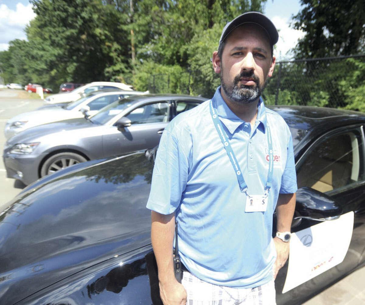 Hour photo/John Nash Jordan Guerrero of Norwalk is the transportation director for the Connecticut Open Tennis Tournament.