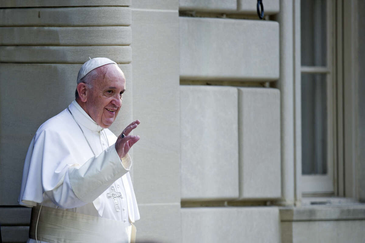 Pope Francis waves as he departs the Apostolic Nunciature, the Vatican's diplomatic mission in Washington, Thursday, Sept. 24, 2015, en route to the Capitol to address a joint meeting of Congress. (AP Photo/Cliff Owen)