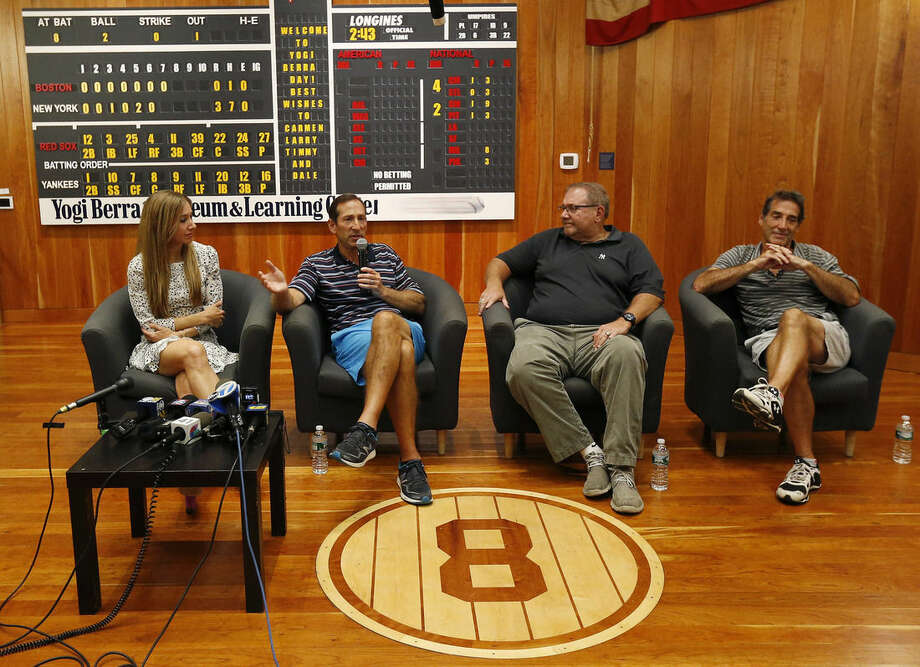 Yogi Berra's oldest granddaughter Lindsay Berra, far left, sits with his sons, from left, Dale, Larry and Tim while talking about the passing of the New York Yankees hall of fame catcher at the Yogi Berra Museum, Thursday, Sept. 24, 2015, in Little Falls, N.J. Berra died Tuesday at the age of 90. (AP Photo/Julio Cortez)