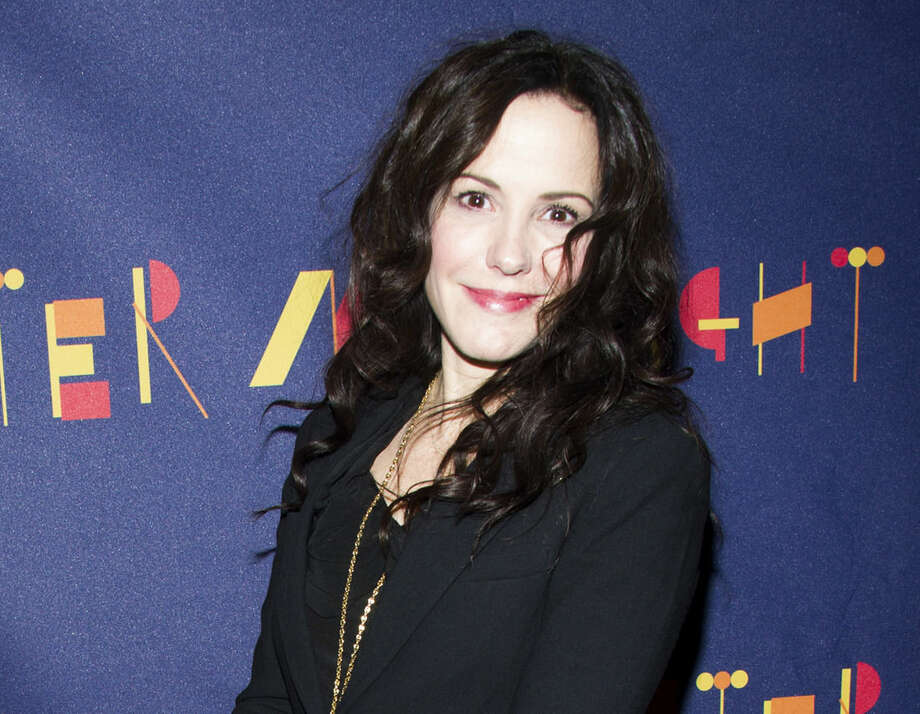 "FILE - In this Nov. 3, 2013 file photo, actress Mary-Louise Parker attends the Broadway opening of ""After Midnight"" in New York. Parker has a collection of thoughtful and emotional personal essays out in November, ""Dear Mr. You,"" which is addressed to various men in her life, but drops no names. (Photo by Charles Sykes/Invision/AP, File)"