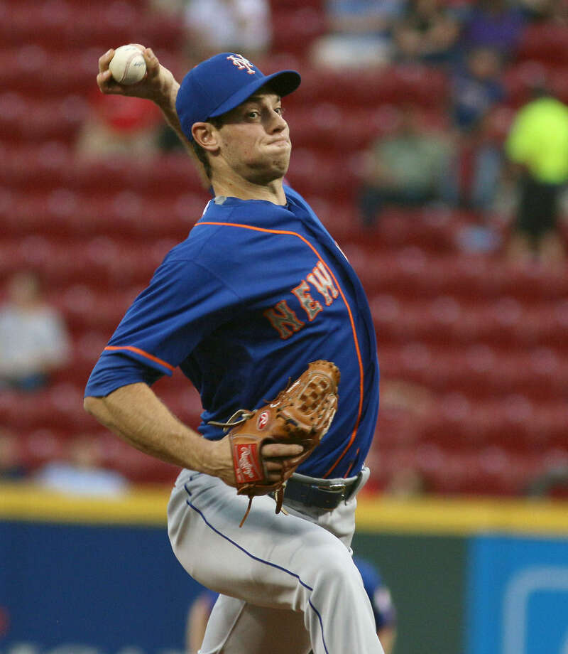 New York Mets' Steven Matz pitches against the Cincinnati Reds in the first inning of their baseball game in Cincinnati, Thursday, Sept. 24, 2015. (AP Photo/Tom Uhlman)