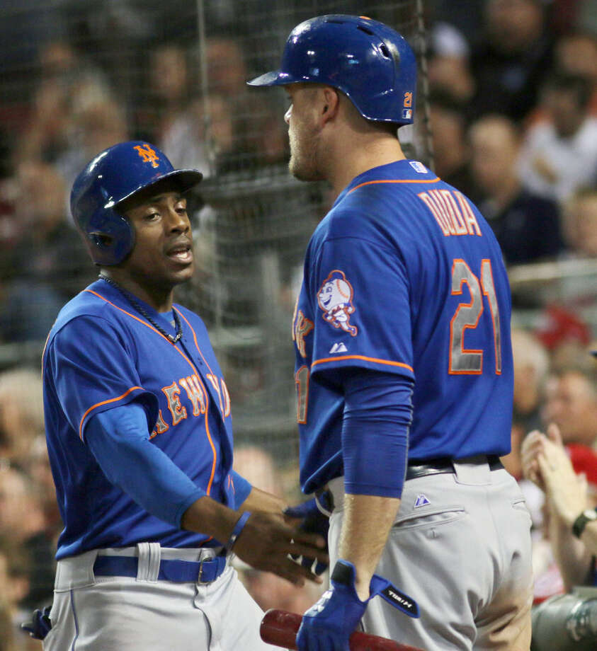 New York Mets Curtis Granderson gets congratulated by Luczs Duda, right, after scoring against the Cincinnati Reds in the seventh inning of a baseball game in Cincinnati, Thursday, Sept. 24, 2015. (AP Photo/Tom Uhlman)