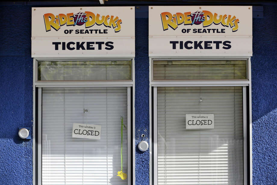 """The ticket booths are closed and shades drawn at the company offices of """"Ride the Ducks"""" after one of their amphibious, military-style tour vehicles was involved in a deadly crash Thursday, Sept. 24, 2015, in Seattle. Several vehicles collided on the busy Aurora Bridge, Thurday. (AP Photo/Elaine Thompson)"""
