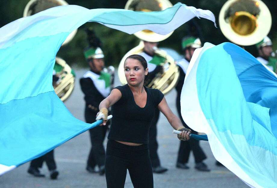 Hour Photo/Alex von Kleydorff Norwalk High School Marching Band performs the 2014 Field show, Dance of the Matador during Spirit Night on Friday.