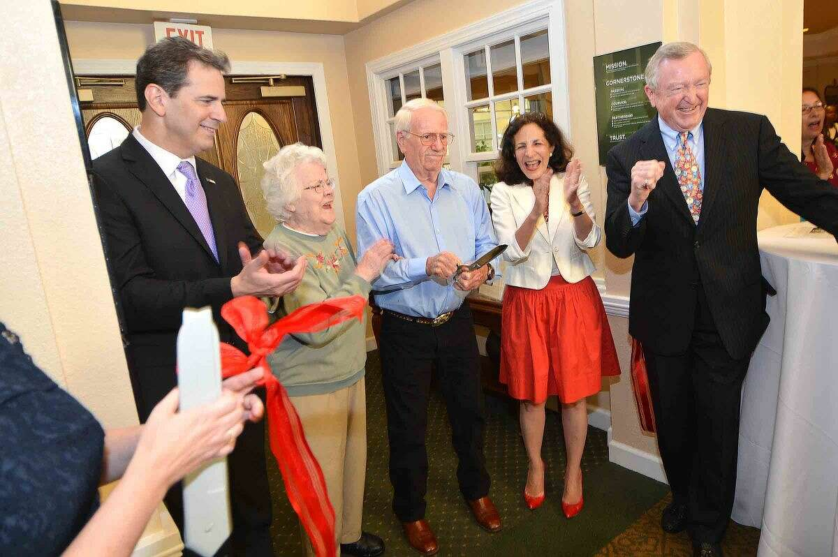State Rep. Chris Perone, residents Miriam Flanagan and Jim Kauhm, with state Rep. Gail Lavielle and First Selectman Bill Brennan, cut the ribbon at Brookdale Wilton.