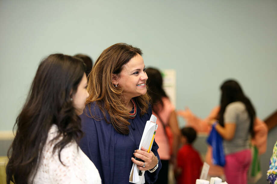 President Gabriela Pena-Perelli chats with vendors during the Latinos Unidos de Connecticut fair at the South Norwalk Community Center Thursday evening. Hour Photo / Danielle Robinson Calloway