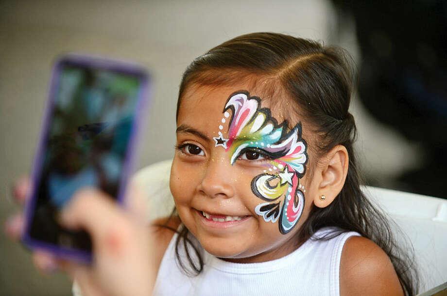 Hour photo / Erik Trautmann Jacquelyn Ortega, 6, gets her face painted at the St. George Greek Orthodox Church annual Greek festival Saturday.