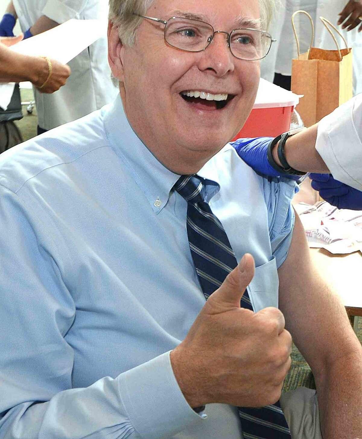 Mayor David Martin gets his flu shot Tuesday morning at the Stamford Government Center.