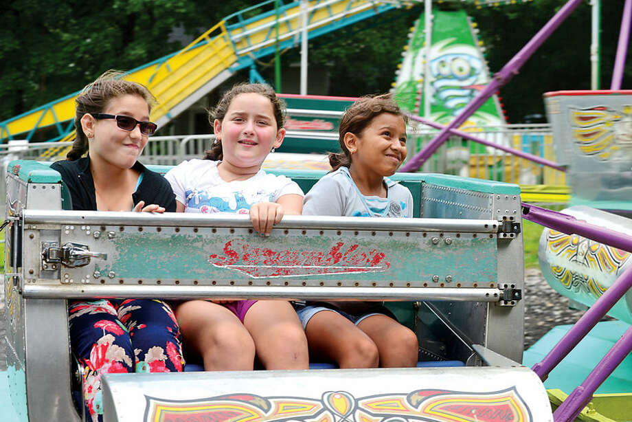 Hour photo / Erik Trautmann Thespina Kiriakidis, Elenie Petridis and Lorilei Membreno ride The Scrambler at the St. George Greek Orthodox Church annual Greek festival Saturday.