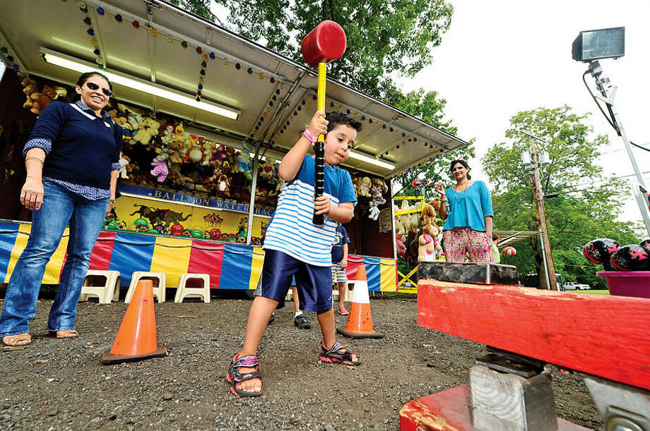 Hour photo / Erik Trautmann 4 year old Sephr Hafizi tries to ring the bell on the Big Stryker at the St. George Greek Orthodox Church annual Greek festival Saturday.