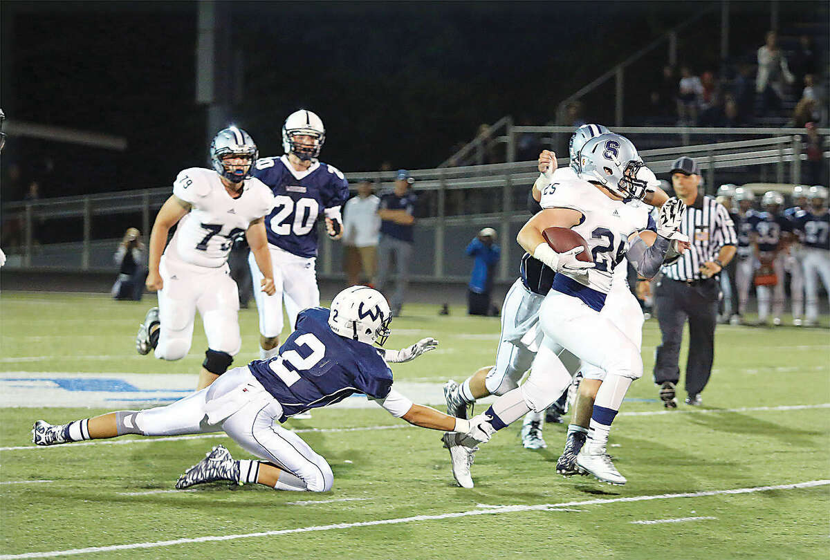 Staples #25, Ethan Burger, runs with the ball during a game against Wilton at Fujitani Field Friday evening. Hour Photo / Danielle Calloway