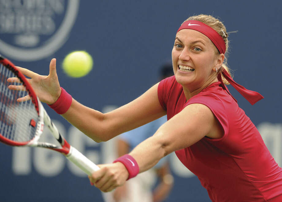 AP photoPetra Kvitova stretches for a backhand during her victory over Magdalena Rybarikova in the Connecticut Open final in New Haven Saturday.