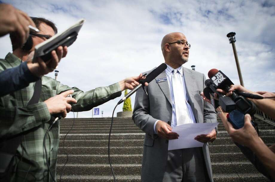 North Seattle College President Dr. Warren Brown reads a prewritten statement to members of the media at North Seattle College on Thursday, Sept. 24, 2015. Four North Seattle College students were killed and dozens injured when a Ride the Ducks vehicle collided with a charter bus on the Aurora Bridge in Seattle, Wash. (Lindsey Wasson/The Seattle Times via AP)