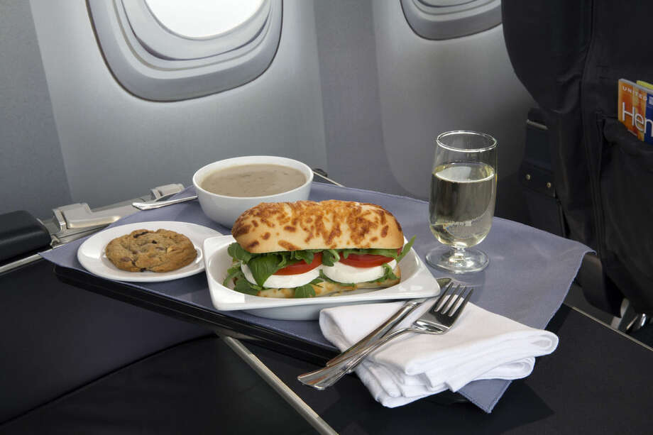 This product image provided by United Airliens shows a Caprese on Asiago Baguette sandwich, one of a variety of the airline's new first class food options. The Chicago-based airline on Thursday, Aug. 21, 2014 announecd that it's upgrading first class food options and replacing snacks with full meals on some of its shortest flights. (AP Photo/United Airlines)