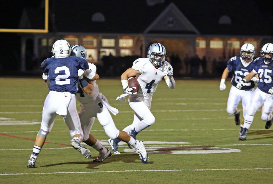 Staples #4, Connor Adrian, runs with the ball during a game against Wilton at Fujitani Field Friday evening. Hour Photo / Danielle Calloway