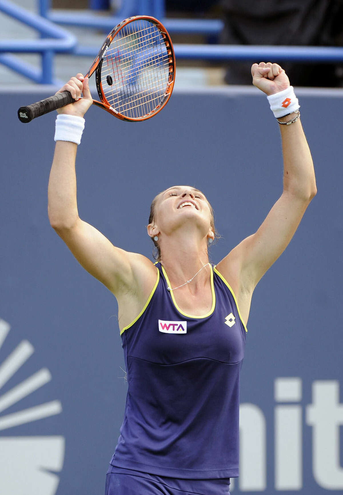 Magdalena Rybarikova, of Slovakia, celebrates after her 7-5, 0-6, 6-4 victory over Alison Riske, of the United States, during a quarterfinal match at the New Haven Open tennis tournament in New Haven, Conn., on Thursday, Aug. 21, 2014. (AP Photo/Fred Beckham)