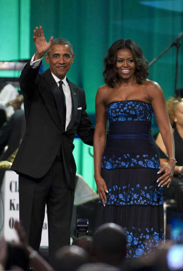 President Barack Obama and first lady Michelle Obama arrive at the Congressional Black Caucus Foundation's 45th Annual Legislative Conference Phoenix Awards Dinner at the Walter E. Washington Convention Center in Washington, Saturday, Sept. 19, 2015, where the president spoke about the challenges facing black women, particularly in the areas of education, employment and criminal justice. ( AP Photo/Jose Luis Magana)