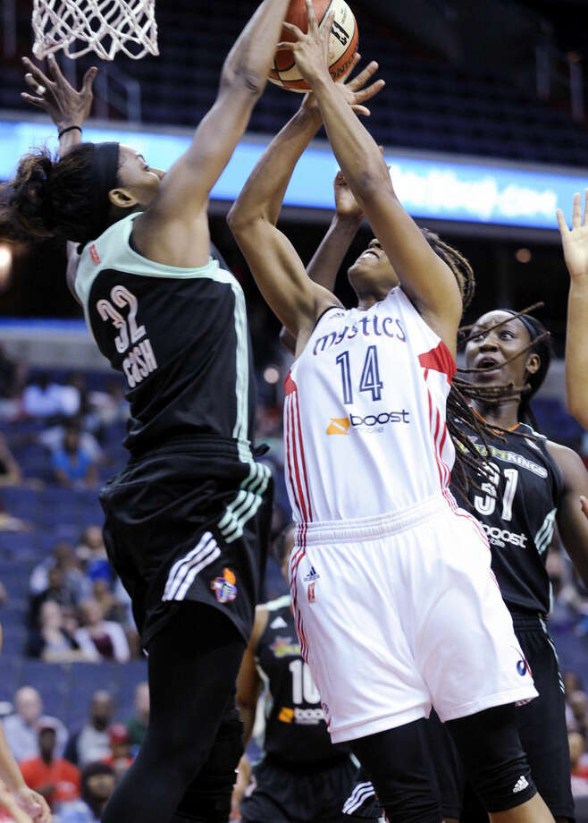 New York Liberty's Swin Cash (32) blocks the shot of Washington Mystics' Tierra Ruffin-Pratt (14) as Liberty's Tina Charles (31) also defends during an WNBA Eastern Conference basketball playoff game on Sunday, Sept. 20, 2015 in Washington. (AP Photo/Kevin Wolf)